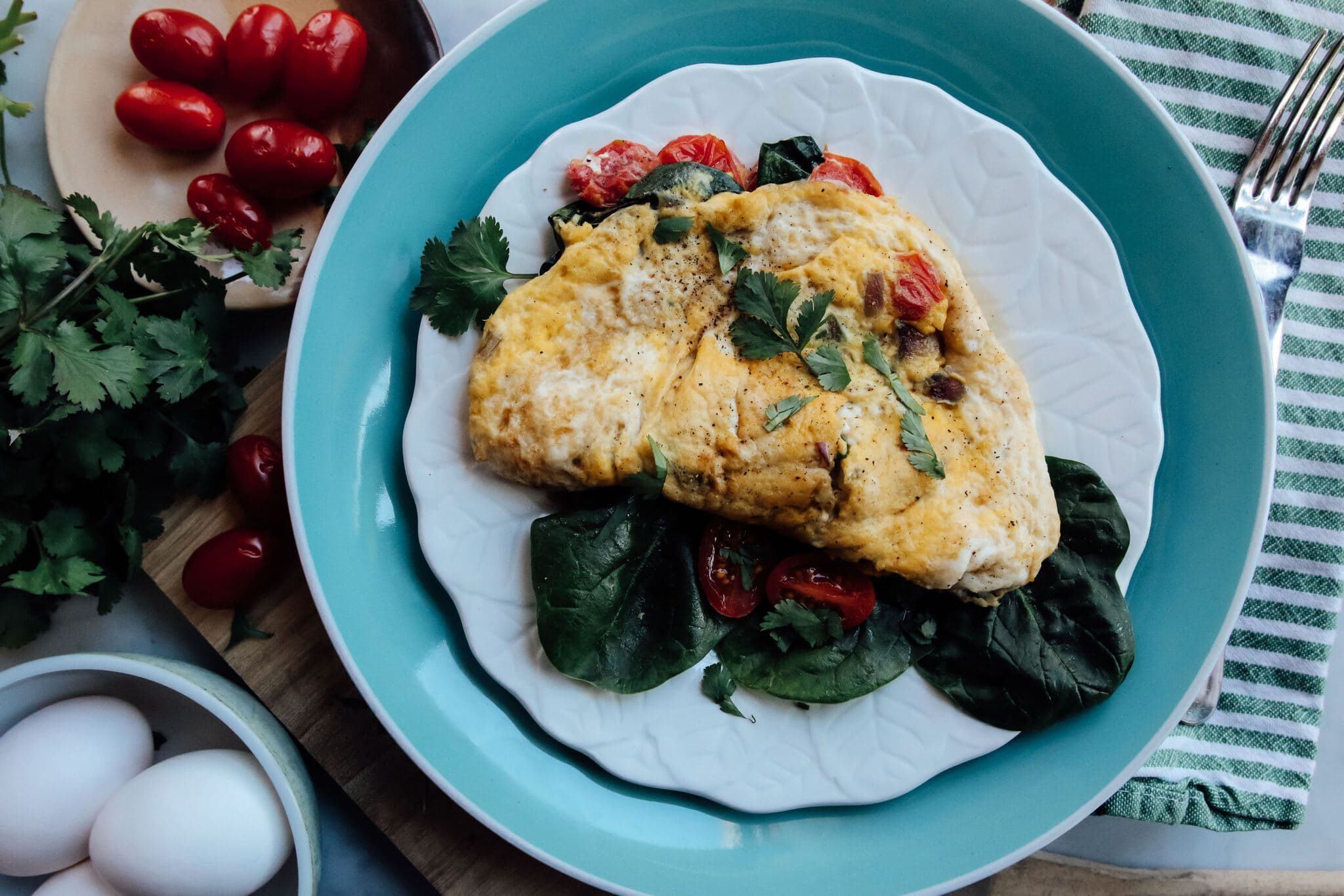 omelet with spinach and tomatoes