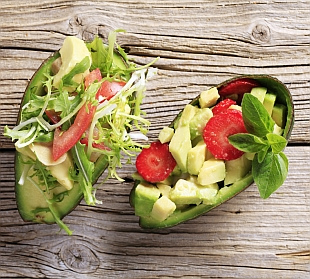 Avocado halves filled with avocado salads - closeup