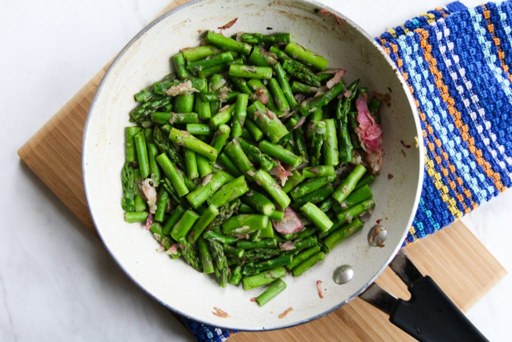 chopped asparagus and bacon in skillet