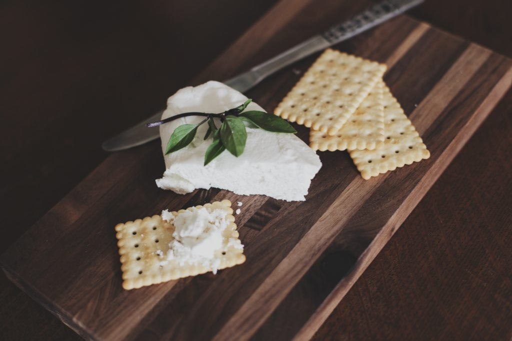 crackers and cheese on cutting board