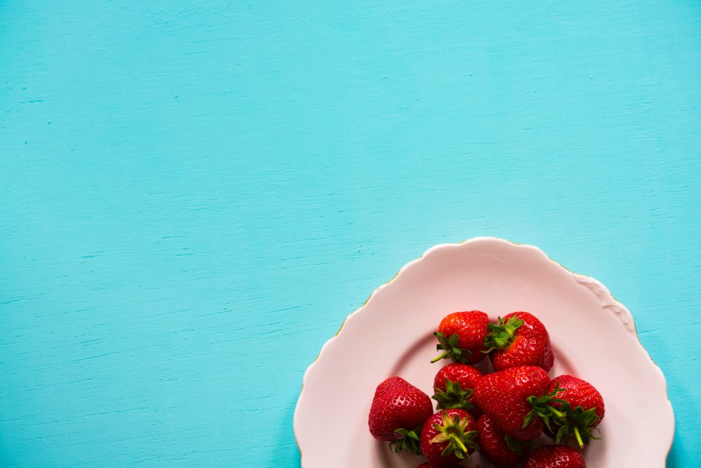 strawberries-white-plate-blue-background
