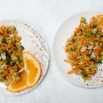 chopped chicken salad on plate with oranges
