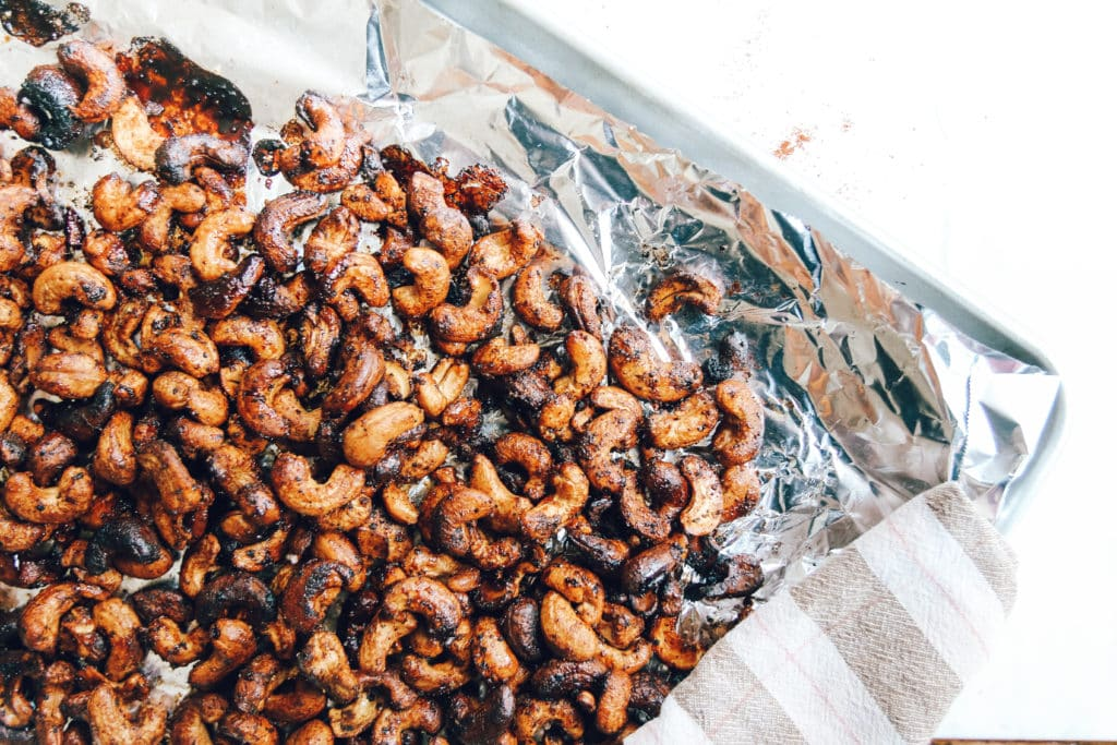 chili roasted cashews on baking sheet