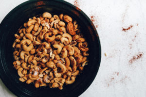 chili roasted cashews in black dish