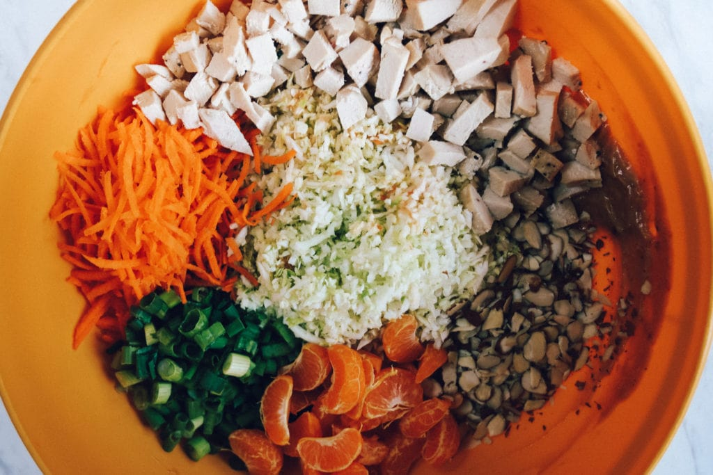chopped chicken salad ingredients in bow