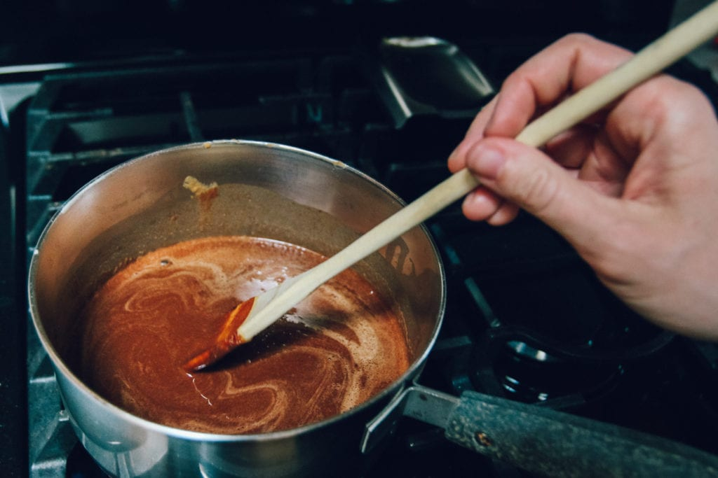chocolate coconut fudge ingredients in saucepan on stove
