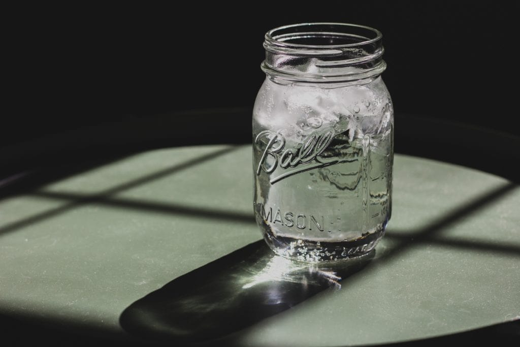 mason jar with water on table
