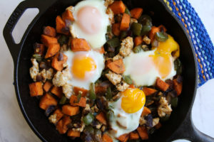 sweet potato turkey vegetable egg hash in cast iron skillet
