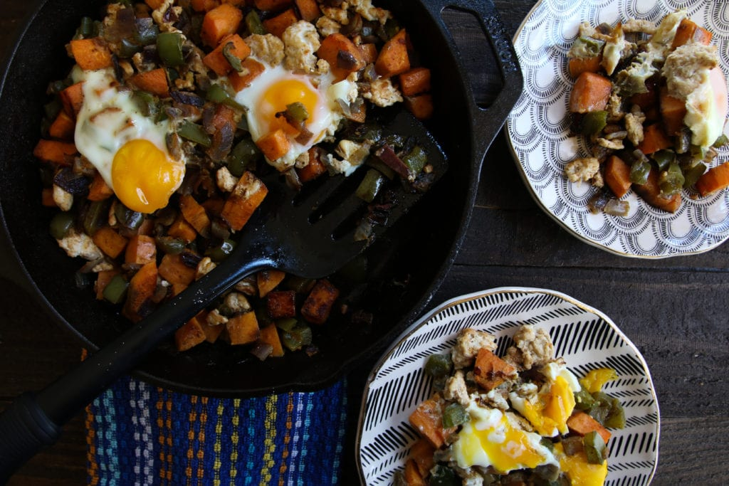 southwest turkey hash in skillet and on plates