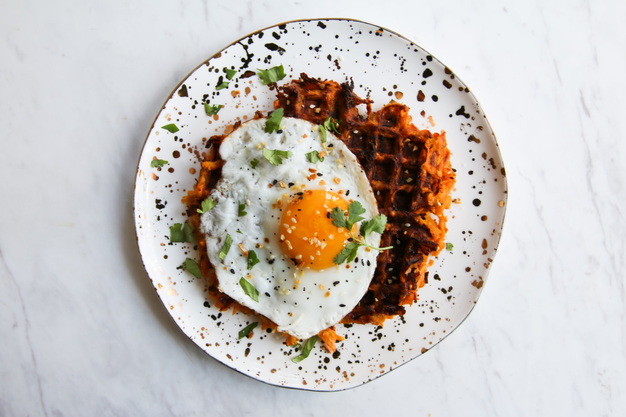 sweet potato waffle hashed browns with egg on top