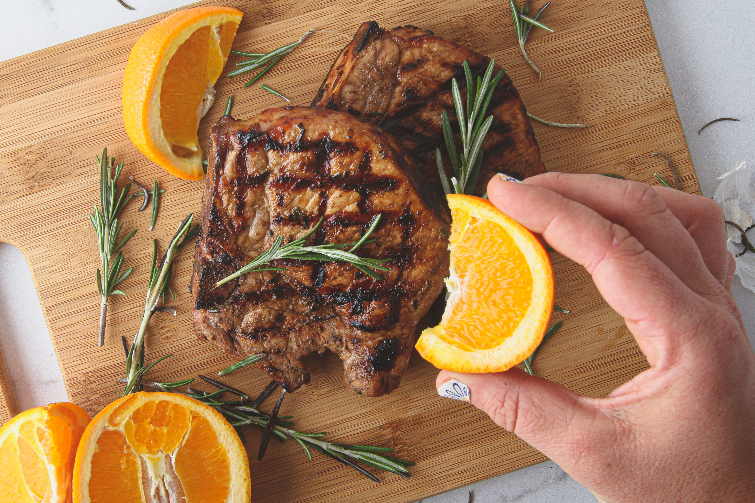 grilled pork chop with rosemary and orange