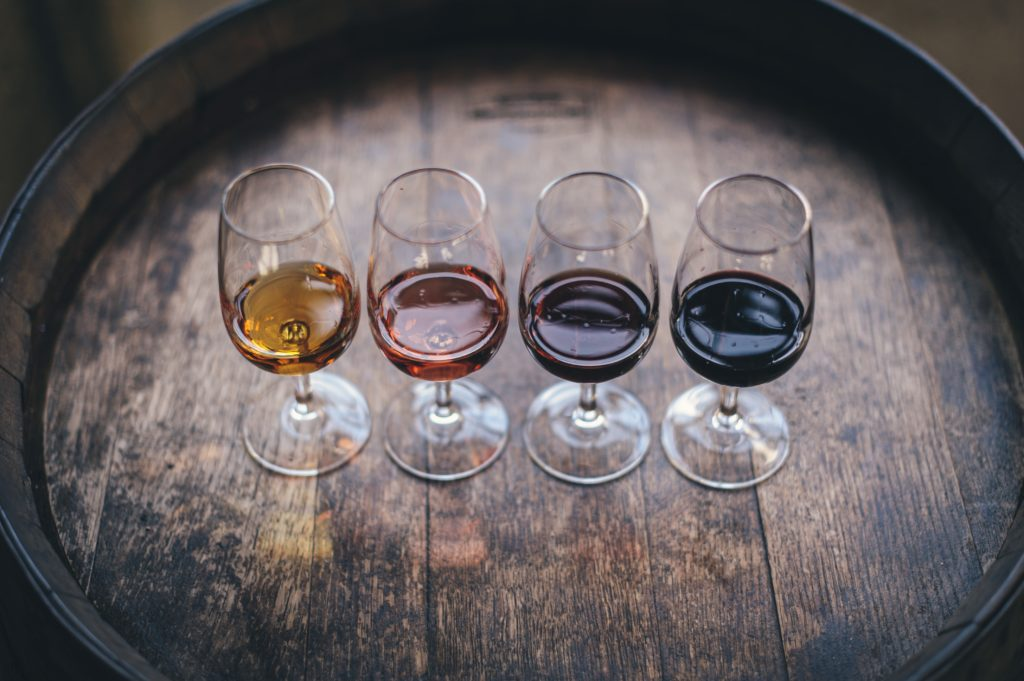 wine glasses sitting on barrel