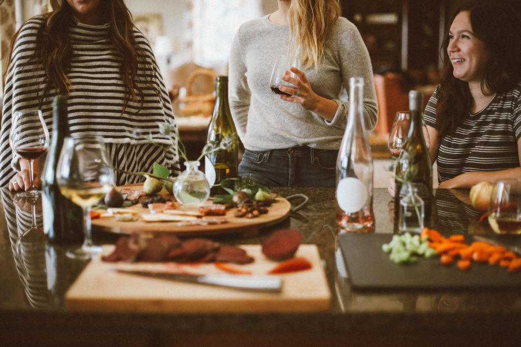 women with wine and food