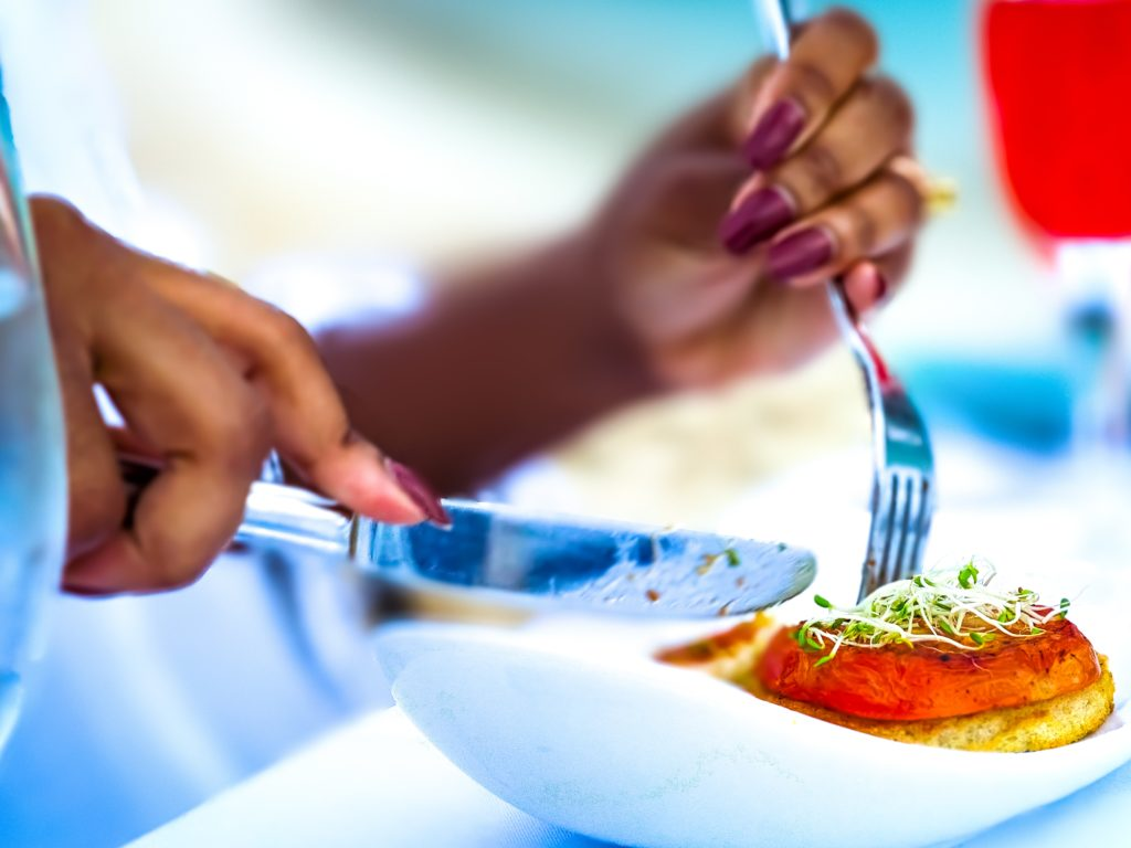 woman holding fork and knife