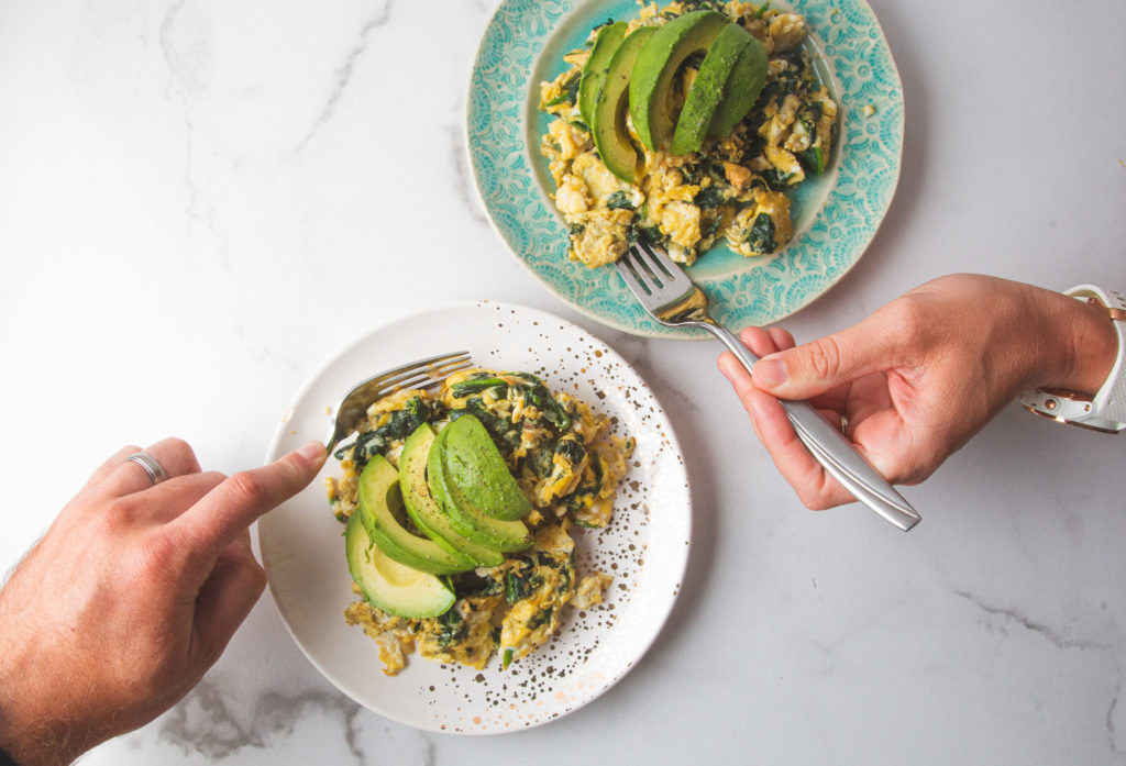 spinach and avocado scramble on plates